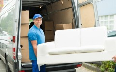Loading sofa onto van